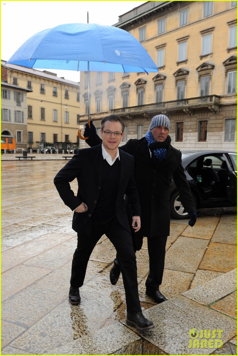 matt damon george clooney get personal umbrella holders in milan 013050709