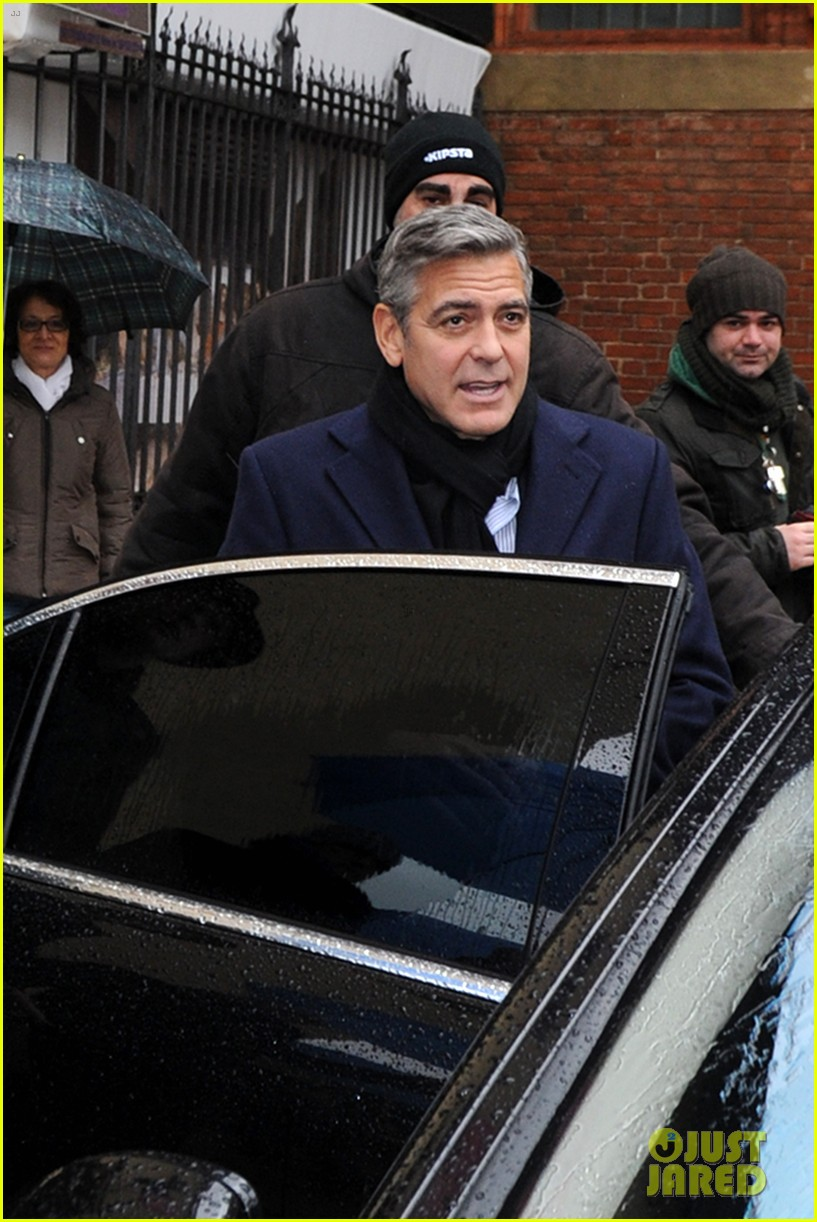 matt damon george clooney get personal umbrella holders in milan 173050725