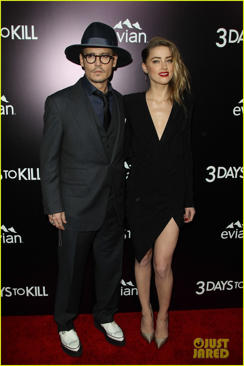 johnny depp supports amber heard at 3 days to kill premiere 093052500
