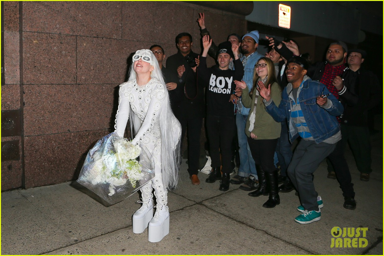 lady gaga is a bride see her throwing a bouquet of flowers 01