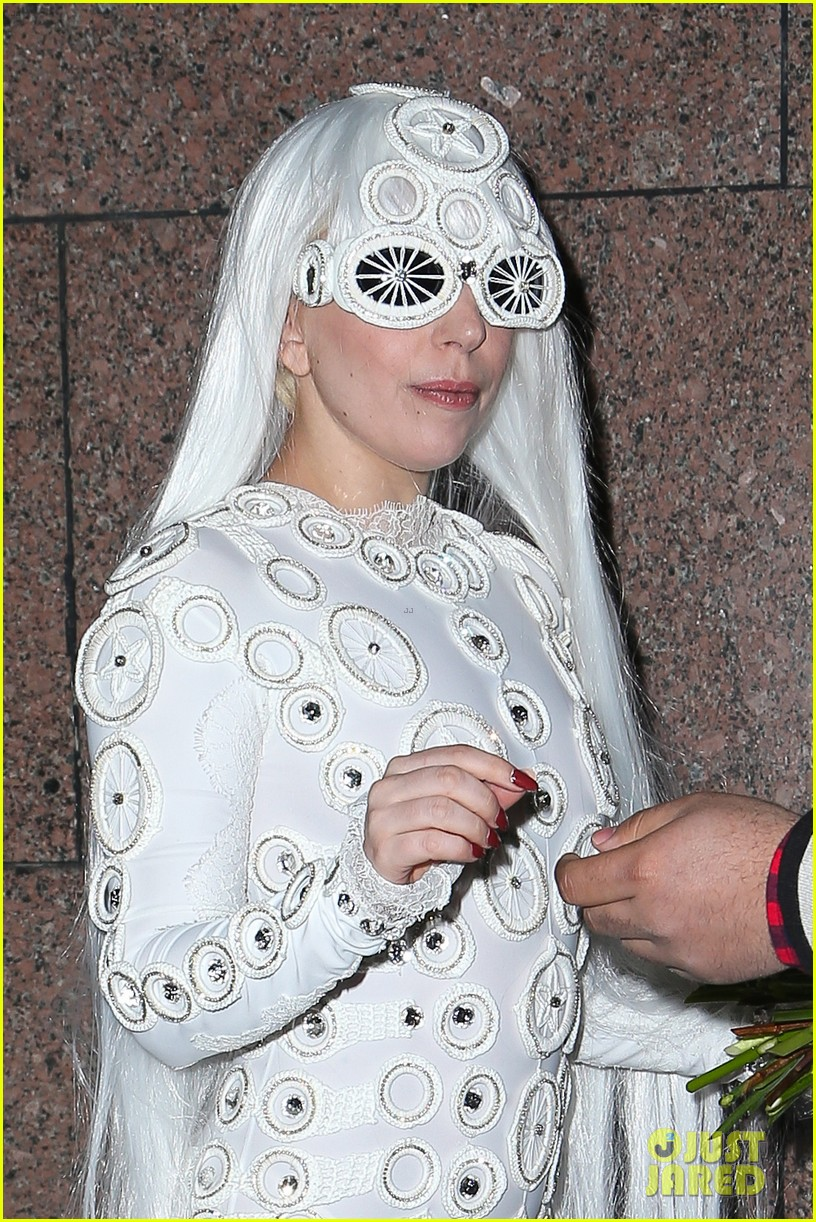 lady gaga is a bride see her throwing a bouquet of flowers 02