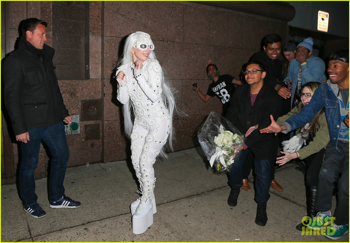 lady gaga is a bride see her throwing a bouquet of flowers 093057629
