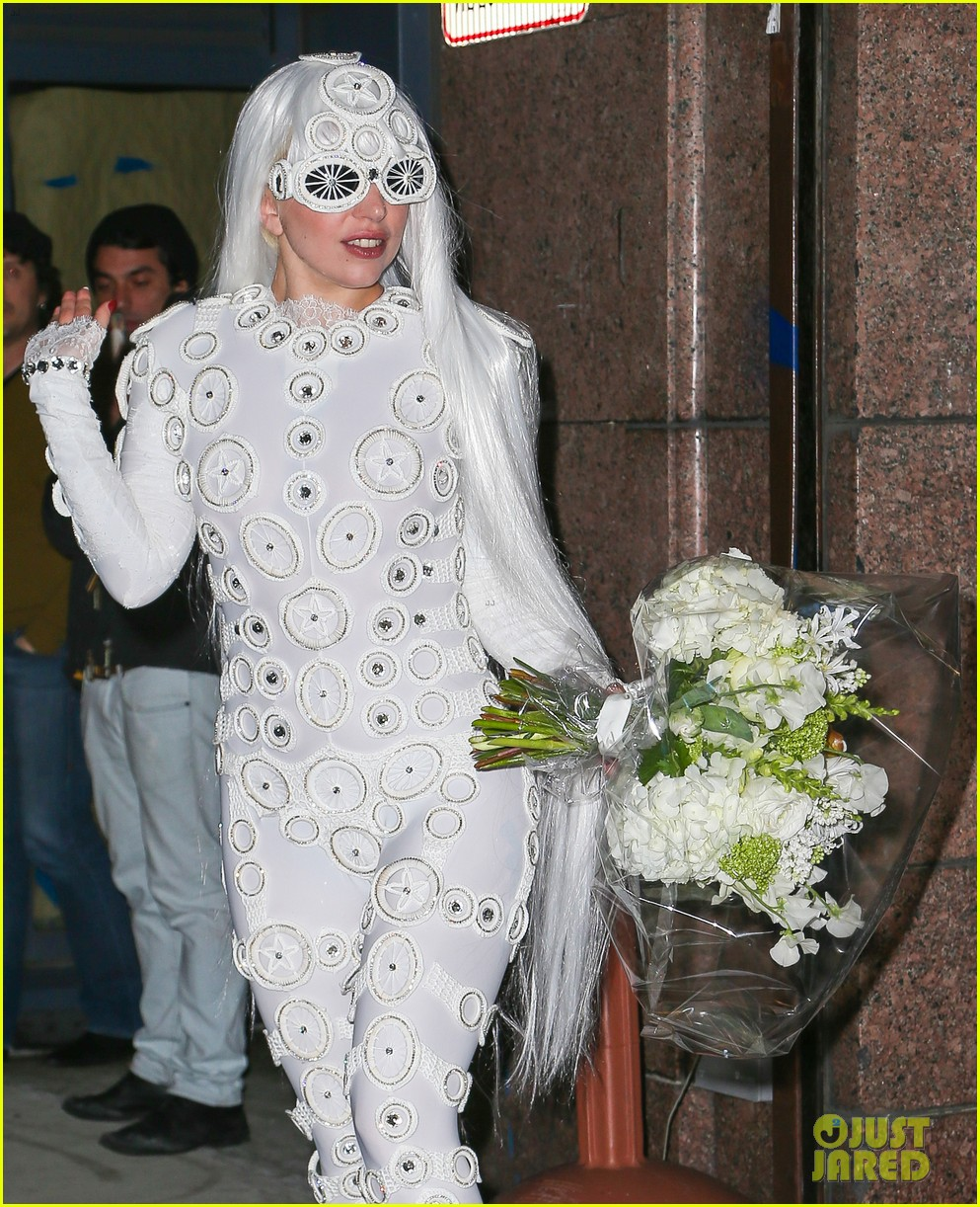 lady gaga is a bride see her throwing a bouquet of flowers 14