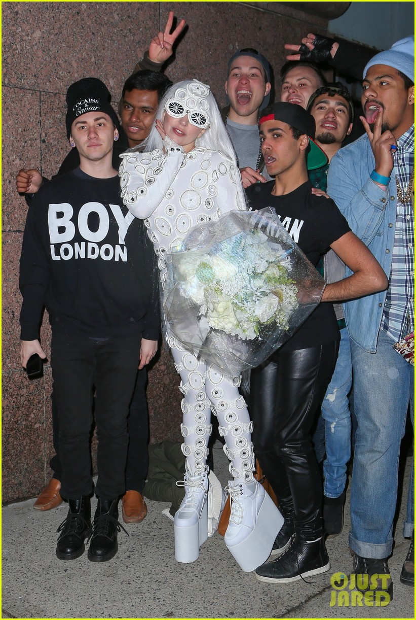 lady gaga is a bride see her throwing a bouquet of flowers 173057637
