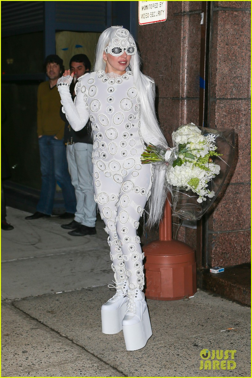 lady gaga is a bride see her throwing a bouquet of flowers 19