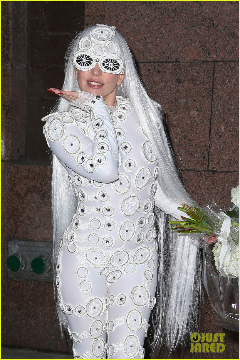 lady gaga is a bride see her throwing a bouquet of flowers 20