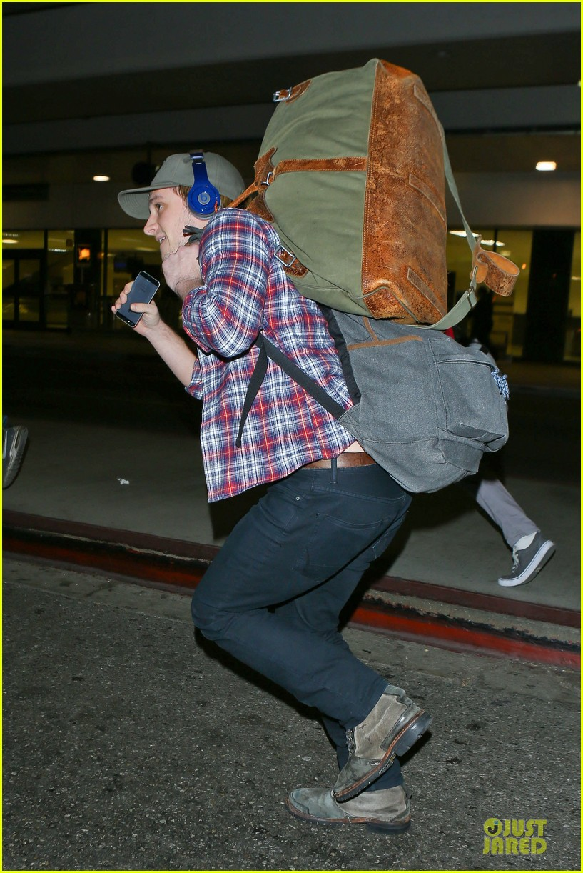 josh hutcherson shows macho strength at lax arrival 01