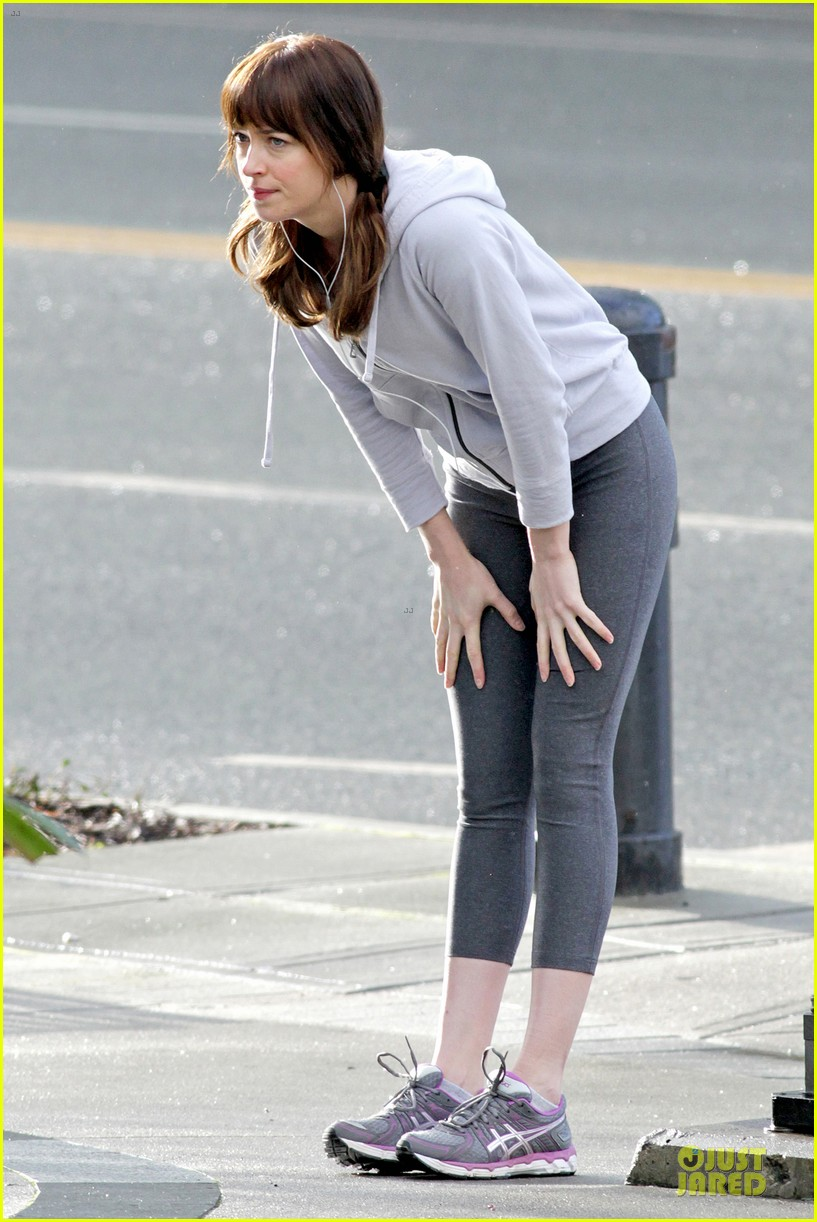 dakota johnson runs for fifty shades in pigtails 053053492