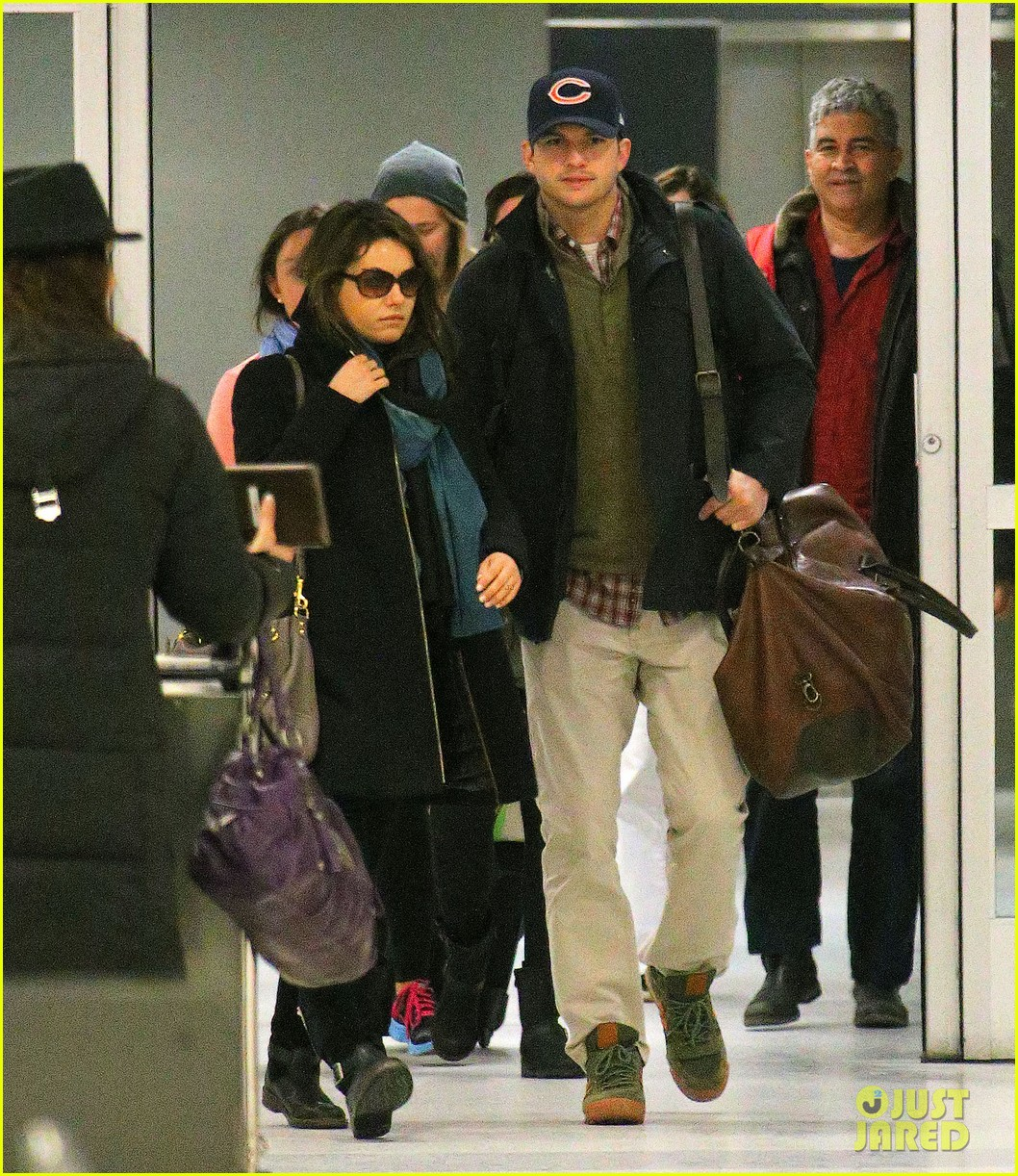 mila kunis ashton kutcher hold hands upon arrival in nyc 04