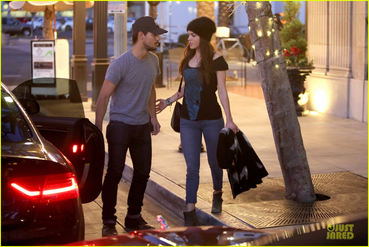 taylor lautner marie avgeropoulos hold hands for dinner 09