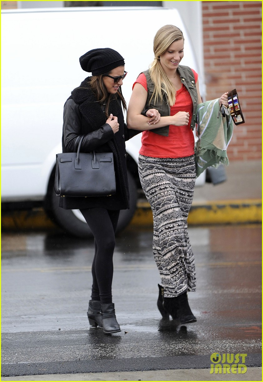 lea michele heather morris walk arm in arm in rainy la 073048848