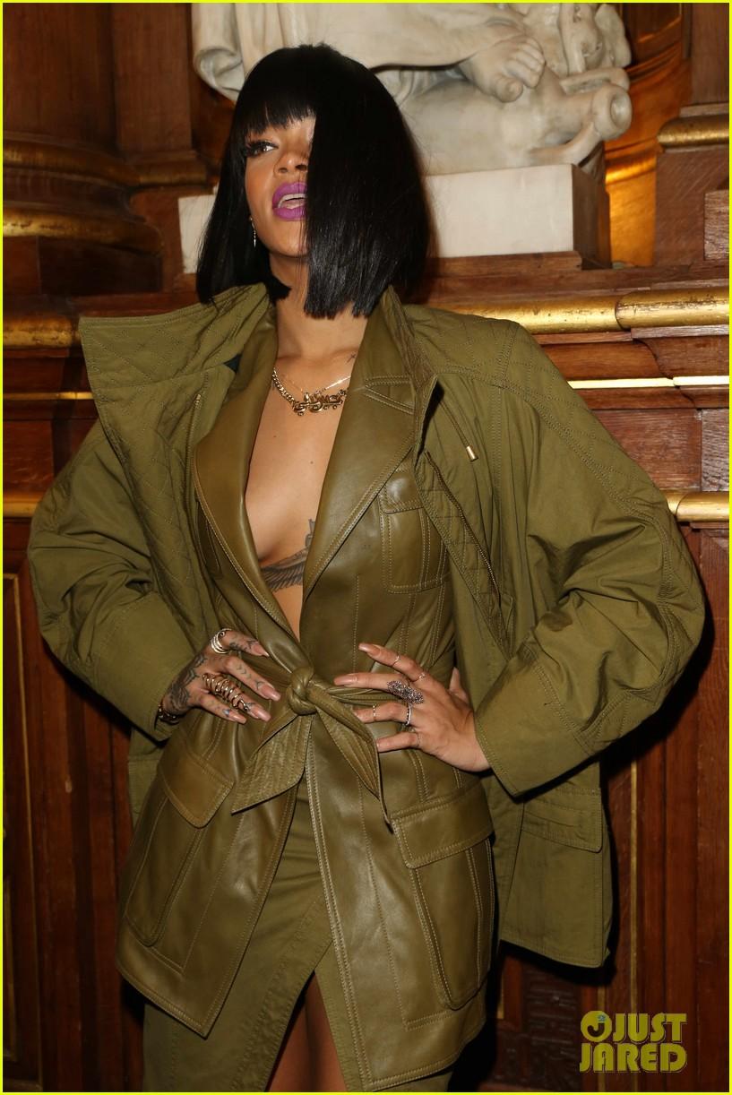 rihanna displays cleavage for balmain paris fashion show 04