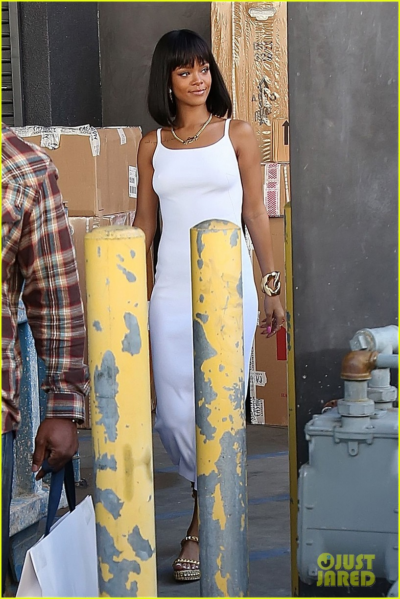 rihanna wears sleek white dress to shop at moncler 113055404