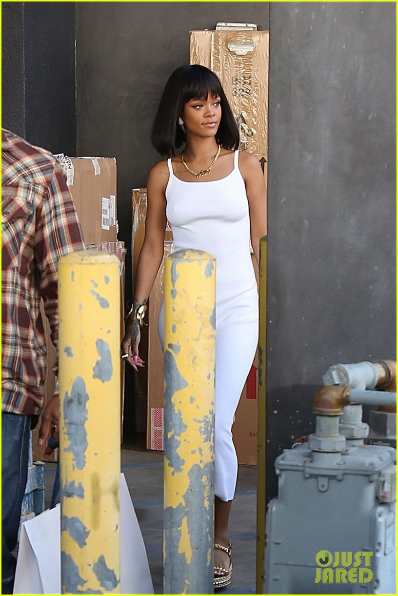 rihanna wears sleek white dress to shop at moncler 15