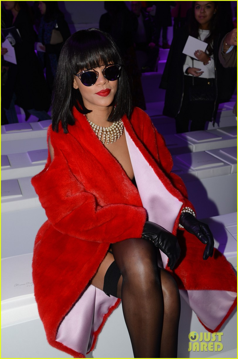 rihanna covers up sexy black outfit with red coat 05