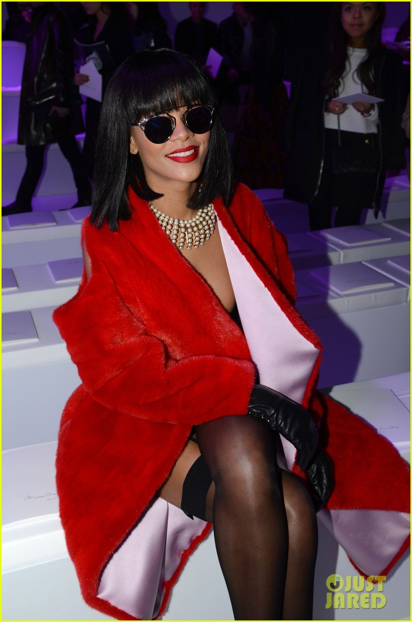 rihanna covers up sexy black outfit with red coat 103062323