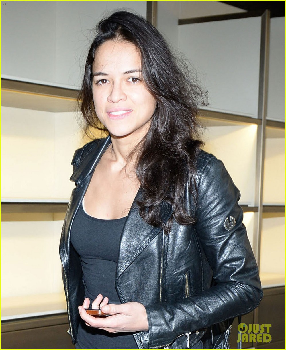michelle rodriguez supports rumored girlfriend cara delevingne at fendi show 06