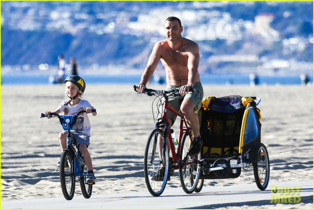 liev schreiber bares hot shirtless bod for family bike ride 253045884