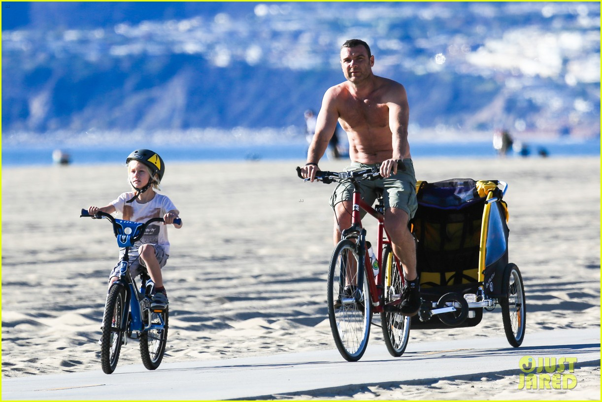 liev schreiber bares hot shirtless bod for family bike ride 273045886