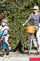 liev schreiber bares hot shirtless bod for family bike ride 23