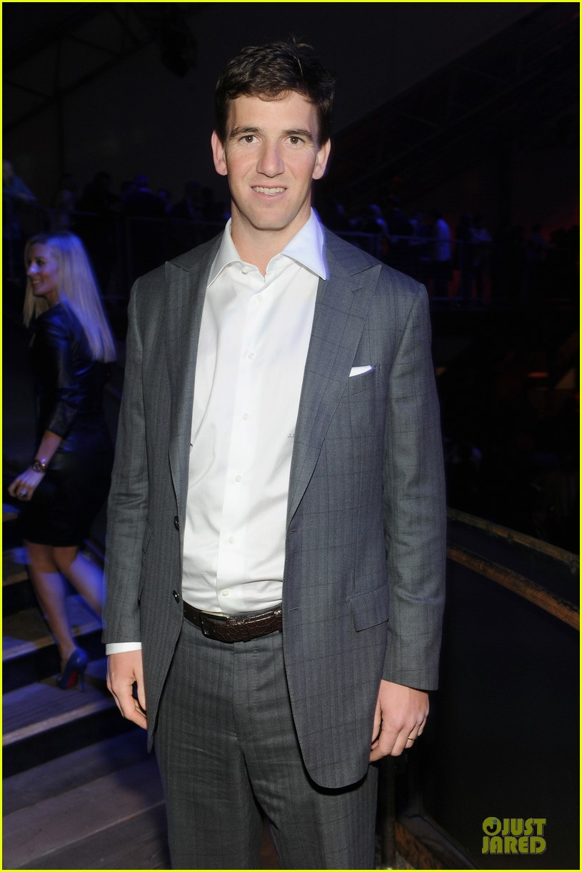 tim tebow eli manning football studs at directv super bowl party 023046322