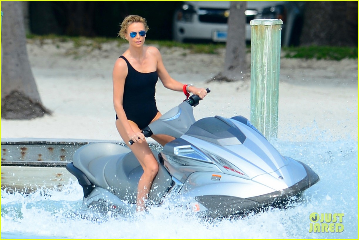charlize therons bathing suit body is so enviable during jet ski shoot 01