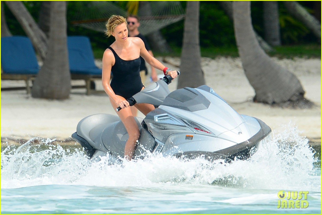 charlize therons bathing suit body is so enviable during jet ski shoot 103075475