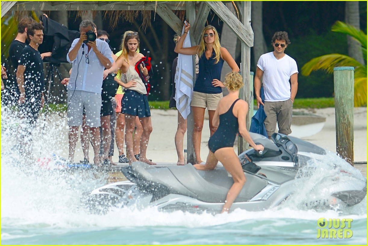 charlize therons bathing suit body is so enviable during jet ski shoot 15