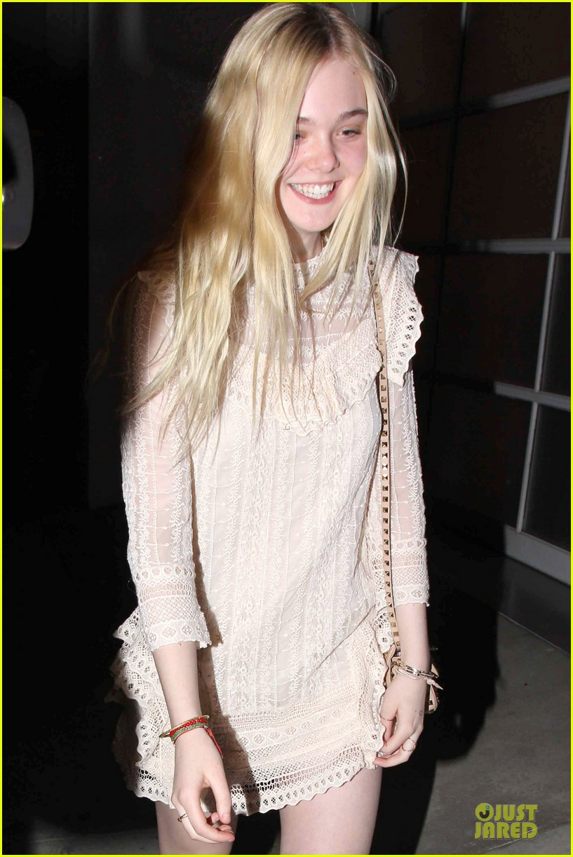 elle fanning teases the cameras in sheer dress at mr chow 04