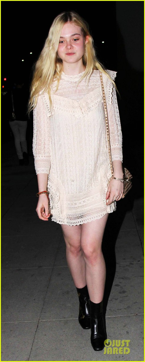 elle fanning teases the cameras in sheer dress at mr chow 07
