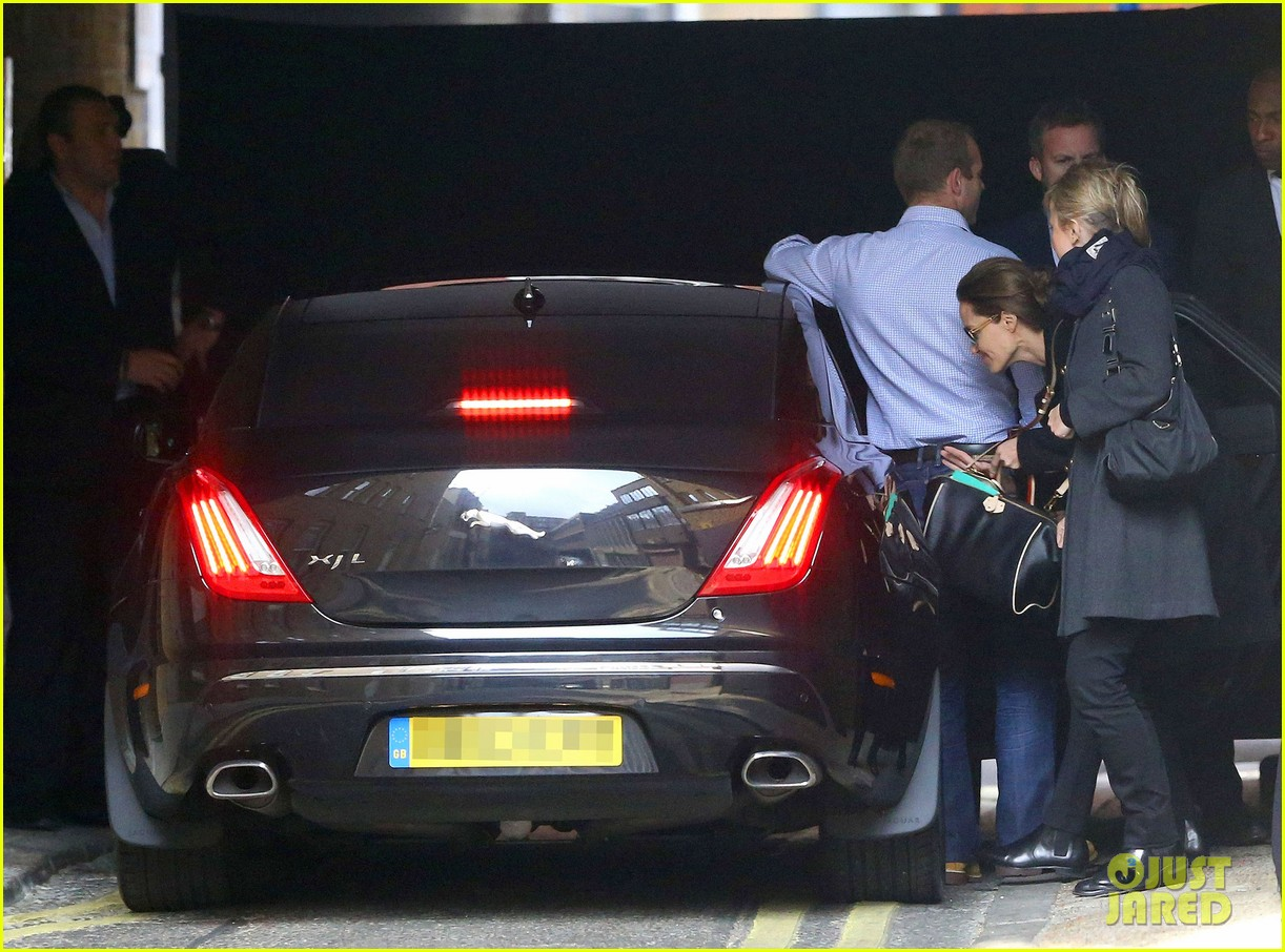 angelina jolie ducks into her car after quick london trip 02