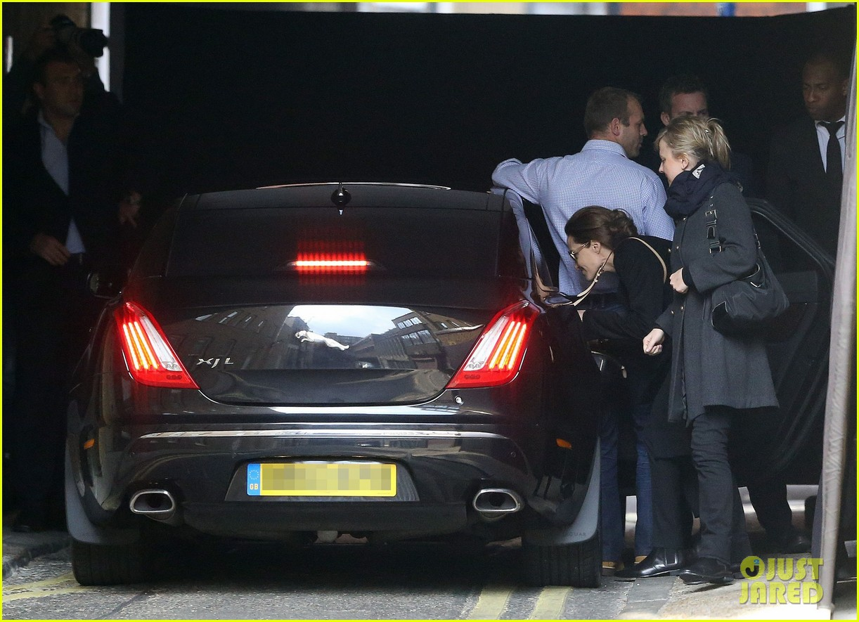 angelina jolie ducks into her car after quick london trip 053079728