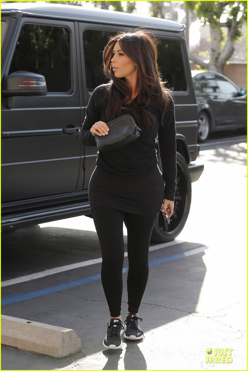 kim kardashian makes a very dark entrance at production office 07