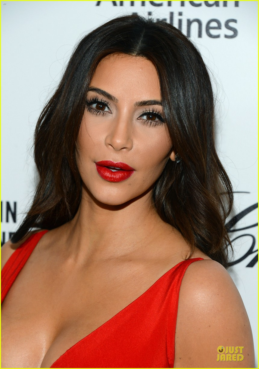 kim kardashian bares cleavage in red dress at elton john oscars party 2014 06