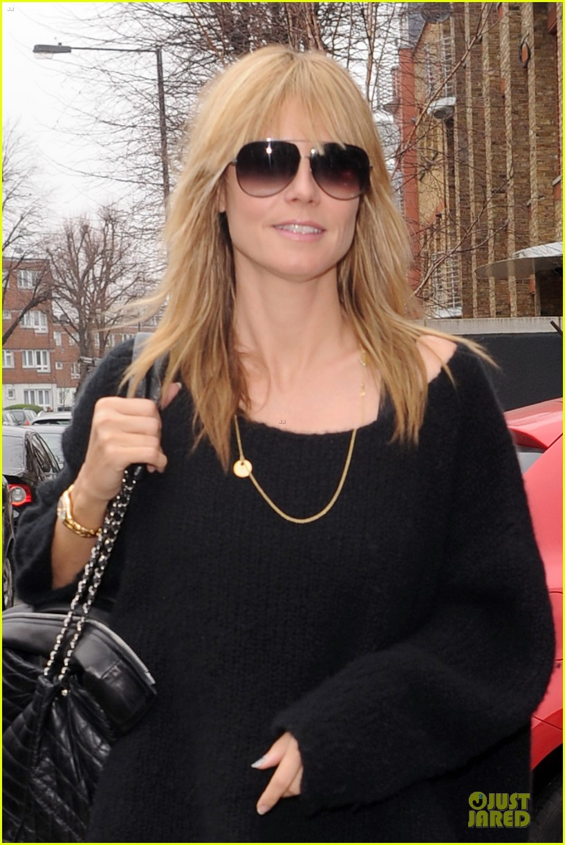 heidi klum stands out with red headphones 19