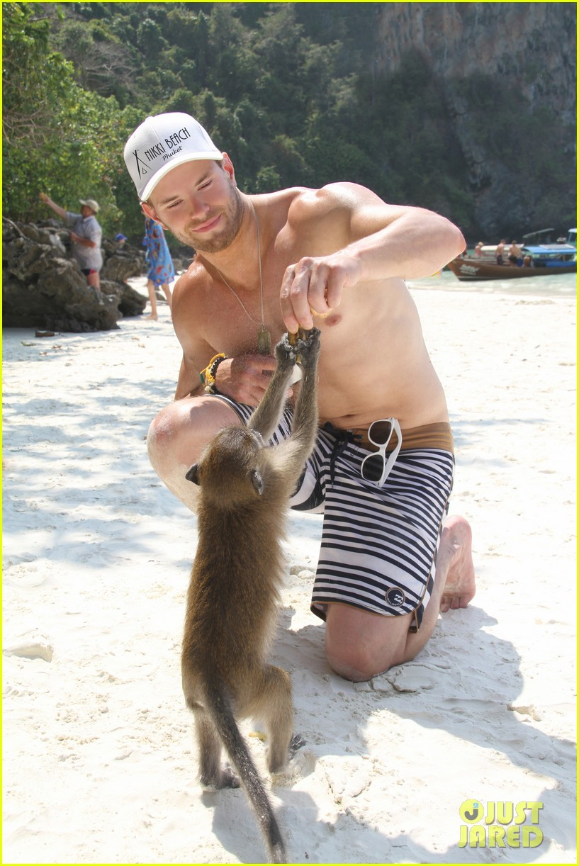 kellan lutz goes shirtless feeds monkey thailand 013070993