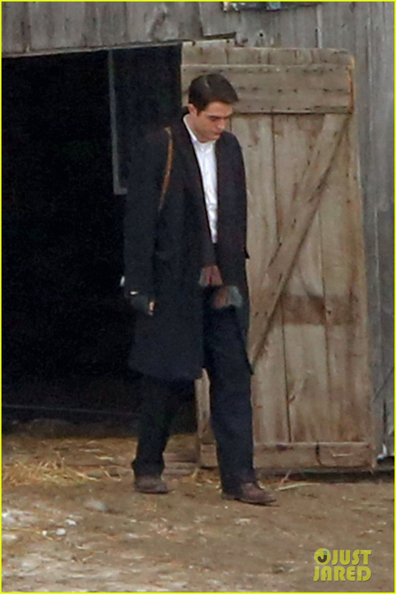 robert pattinson keeps warm with earmuffs on snowy life set 01