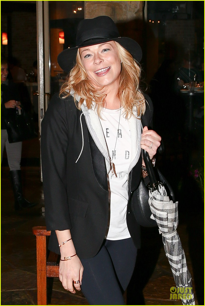 leann rimes fights rain storm with umbrella at tosconova restaurant 02