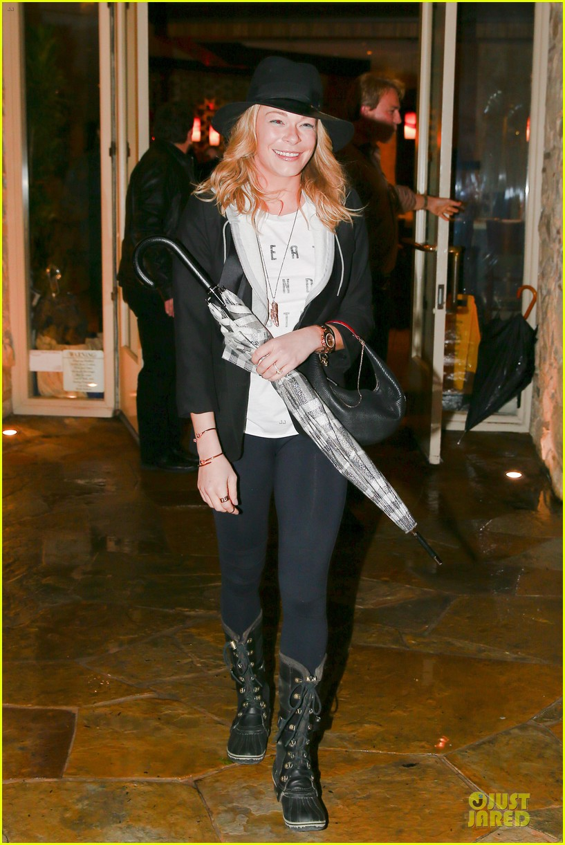 leann rimes fights rain storm with umbrella at tosconova restaurant 12