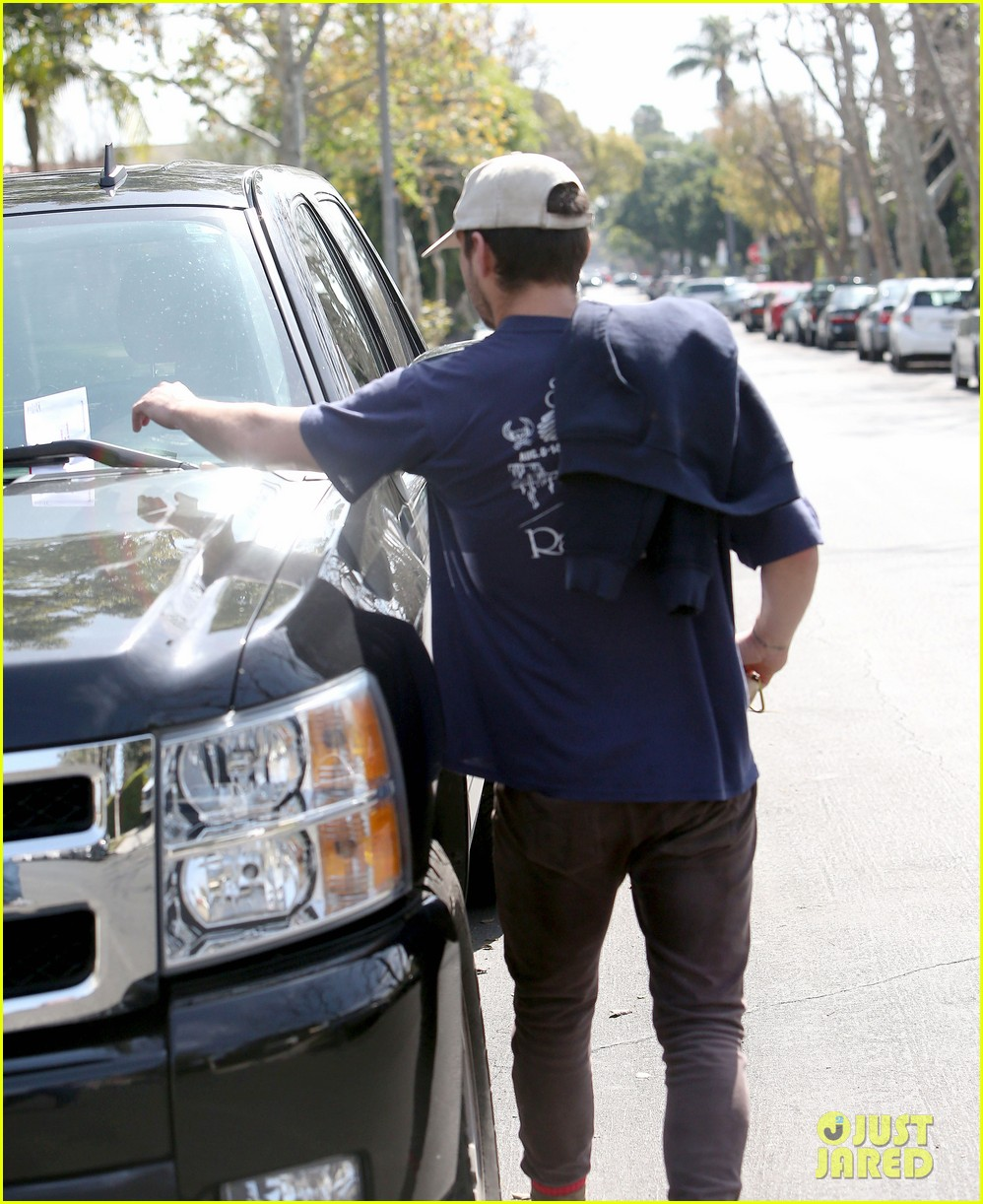shia labeouf finds a parking ticket on his windshield after workout 163065970
