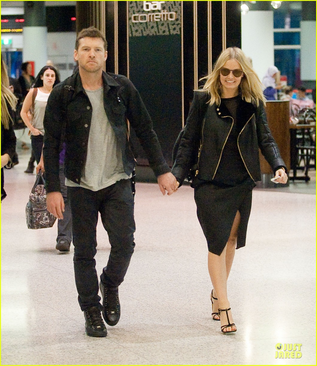 sam worthington lara bingle sydney airport departure 03