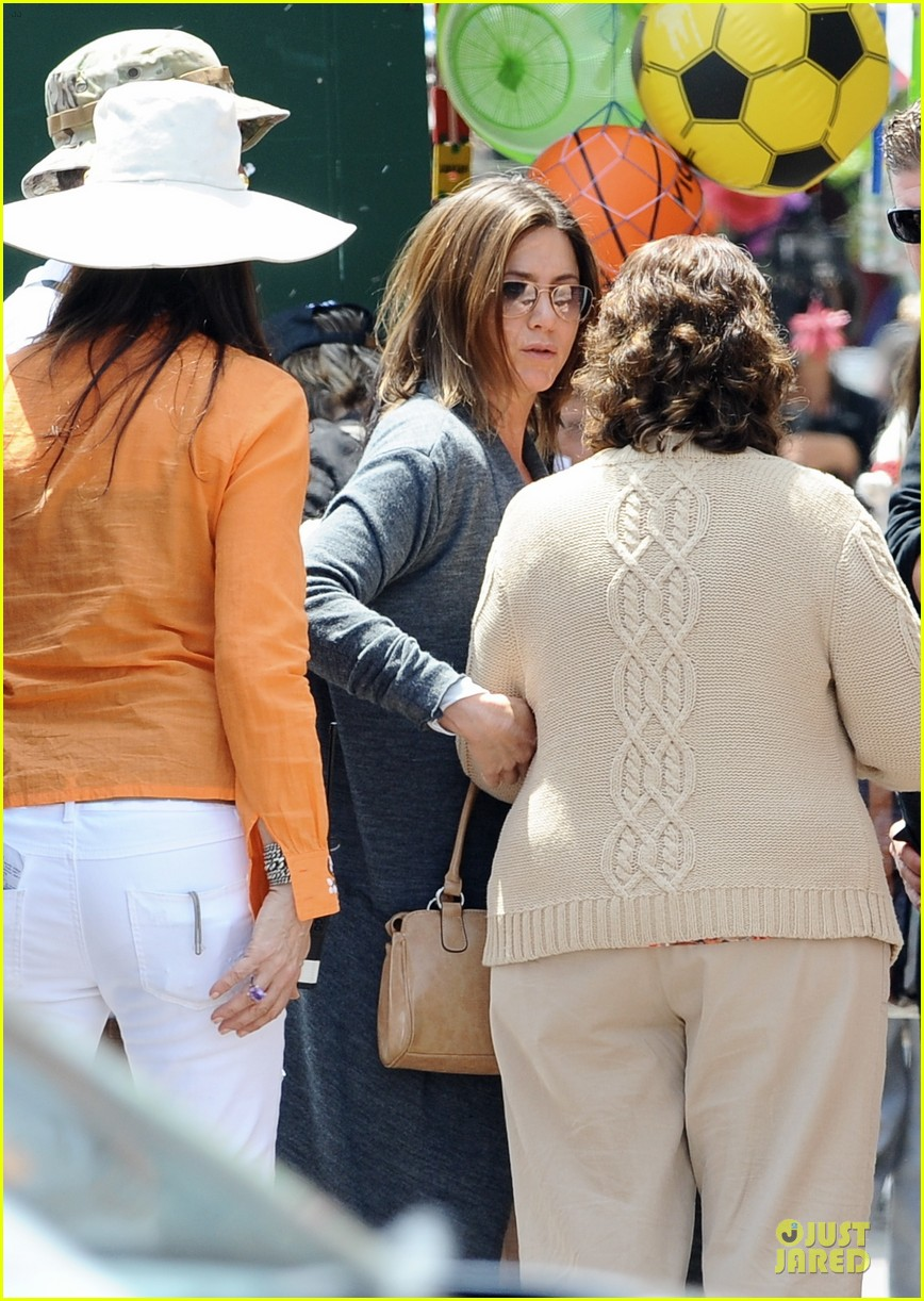 jennifer aniston hides face under a hat 243096932