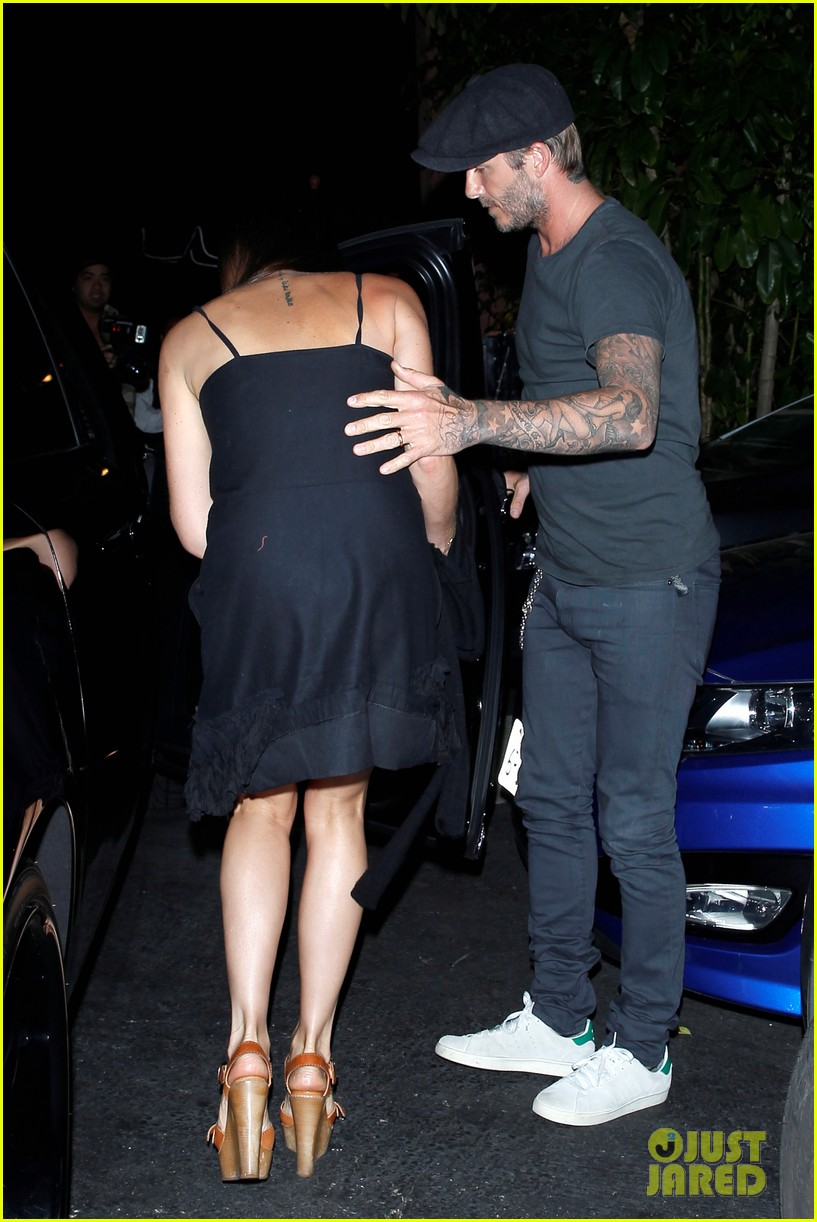 chivalry isnt dead for david beckham as he opens car door for victoria beckham 133086875