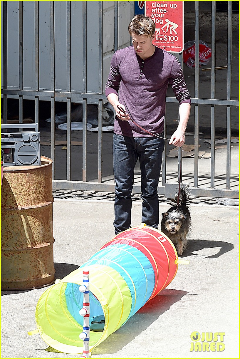 chord overstreet dotes on a dog its really cute 173098259