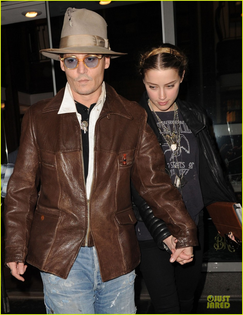 johnny depp amber heard surrounded by books 023097132