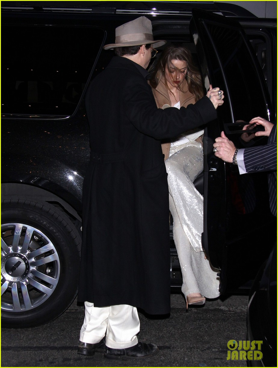 johnny depp amber heard hold hands at cabaret opening 05