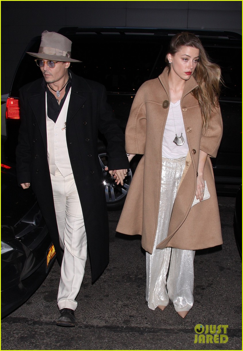 johnny depp amber heard hold hands at cabaret opening 123098569