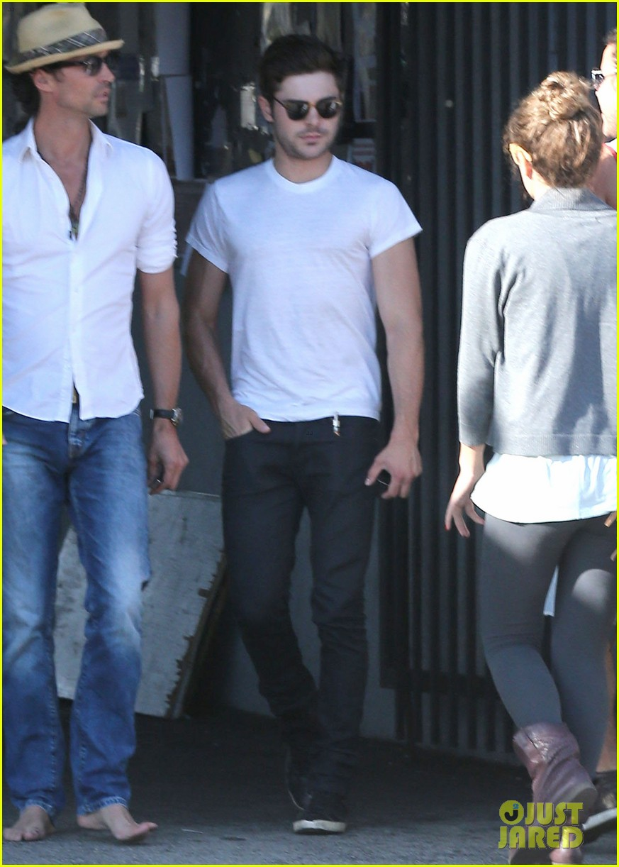 zac efron toned arms shopping guitars 143084144