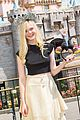 elle fanning boyfriend hold hands at disneyland 05