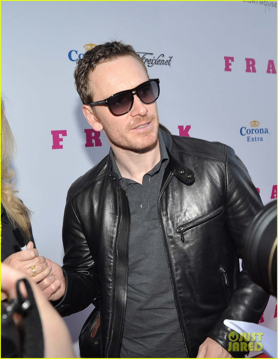 michael fassbender works the red carpet in a leather jacket 05